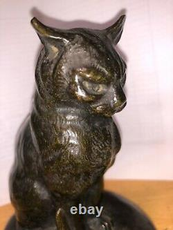 Cat Sitting In Front Of A Bronze Snail Sign Mohler, Cast Old Belle Qualite
