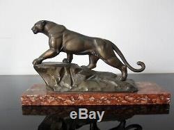 Ancienne sculpture panthère. Statuette régule patine bronze. Art déco