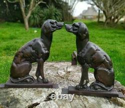 Paire de chenet en bronze chien assis
