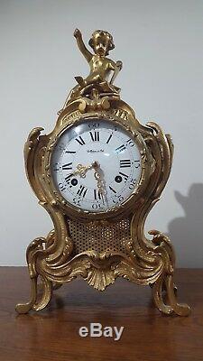 Pendule cartel en bronze collection d'art Horloge