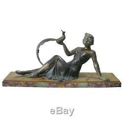 Statue Art-Déco en bronze argenté femme au faisan socle en marbre L = 48 cm