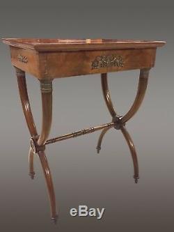 Table à ouvrage acajou bronzes dorés style Empire piétement curule